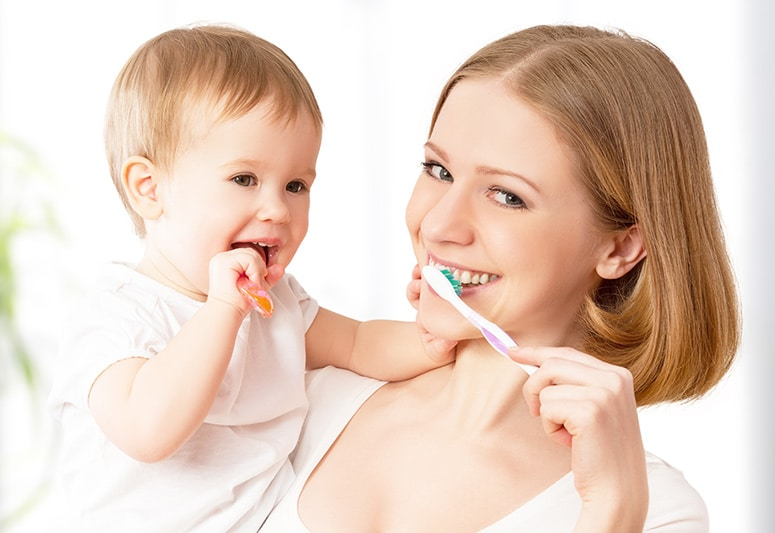 mommy and baby practicing for their first dental visit