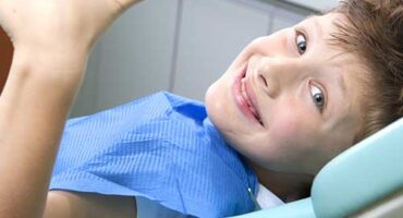 child has a cavity sitting in a dental chair