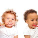 2 babies brushing teeth