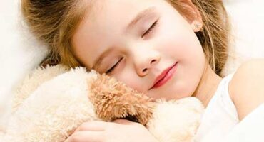 child sleeping with cuddle